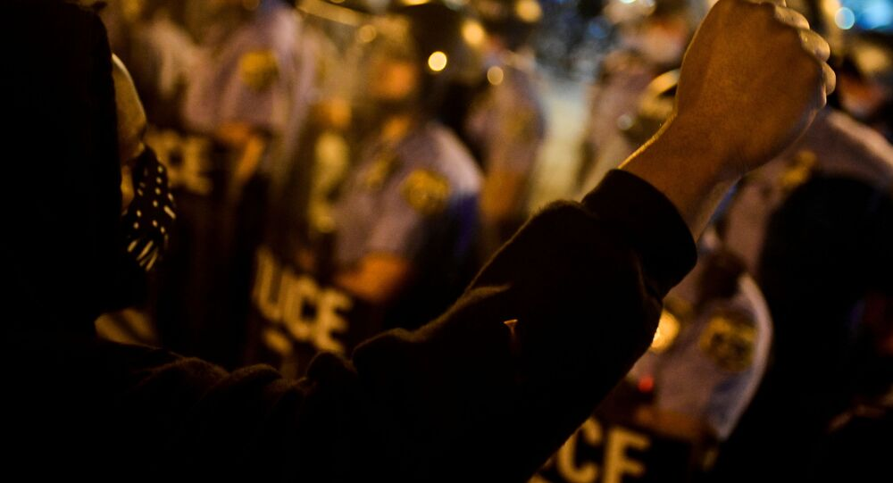 A demonstrator raises his fist during a rally after the death of Walter Wallace Jr., a Black man who was shot by police in Philadelphia, Pennsylvania, U.S., October 27, 2020.
