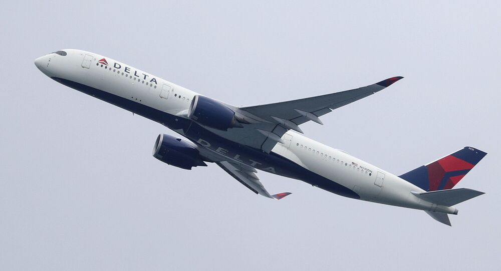 A Delta Air Lines Airbus A350-900 plane takes off from Sydney Airport in Sydney, Australia, October 28, 2020.