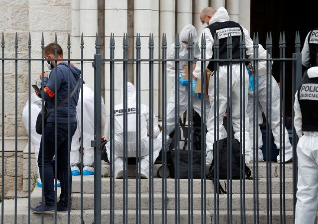 Forensic specialists inspect the scene of a reported knife attack at Notre Dame church in Nice, France, October 29, 2020