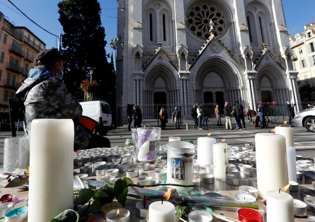 Candles and flowers are seen near the Notre Dame church in tribute to the victims of a deadly knife attack in Nice, France, October 30, 2020.