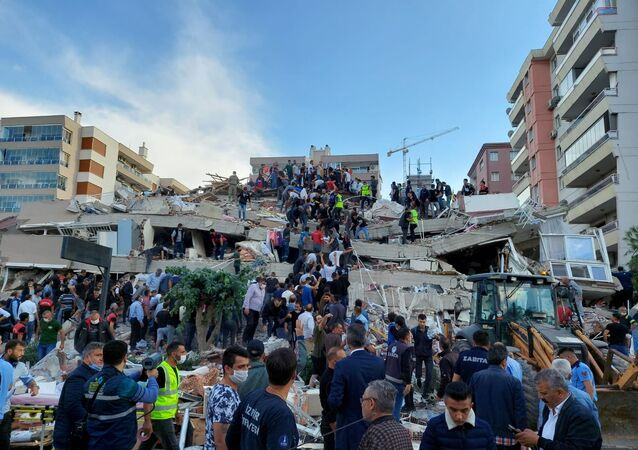 Locals and officials search for survivors at a collapsed building after a strong earthquake struck the Aegean Sea on Friday and was felt in both Greece and Turkey, where some buildings collapsed in the coastal province of Izmir, Turkey, October 30, 2020