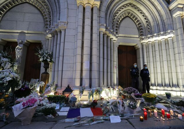 Candles, flowers and messages are seen in front of the Notre Dame church in tribute to the victims of a deadly knife attack in Nice, France, October 30, 2020.