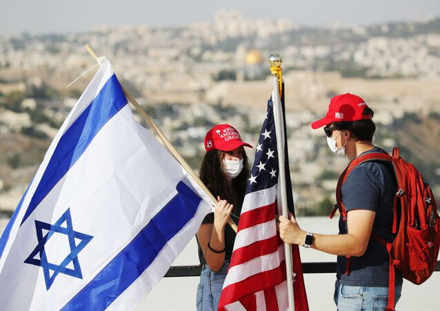 Activists hold American and Israeli flags after joining a convoy to the U.S. Embassy in Jerusalem to show support for U.S. President Donald Trump, ahead of the upcoming U.S. election, in Jerusalem October 27, 2020.
