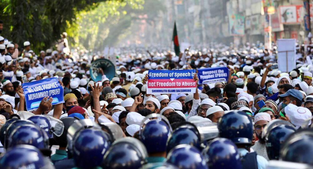 Muslims take part in a protest after Friday prayer, calling for the boycott of French products and denouncing French president Emmanuel Macron for his comments over Prophet Mohammed's caricatures, in Dhaka, Bangladesh, October 30, 2020.