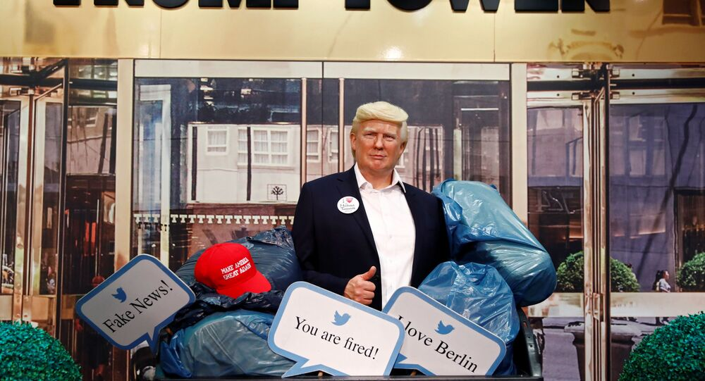 A wax figure depicting U.S. President Donald Trump is put into a dumpster at Madame Tussauds in Berlin, Germany, October 30, 2020.
