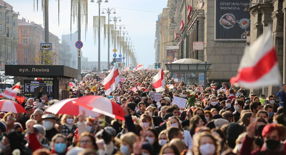 People attend an opposition rally to reject the Belarusian presidential election results in Minsk, Belarus October 26, 2020.