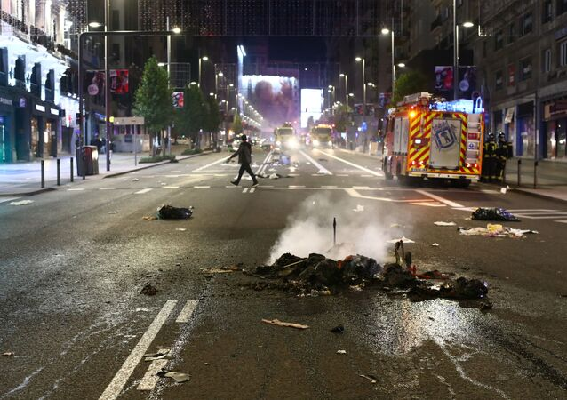 A pile of burned objects are seen on the road during a protest against the closure of bars and gyms, amidst the coronavirus disease (COVID-19) outbreak, in Madrid, Spain, November 1, 2020.