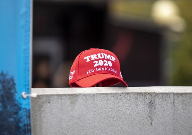 A supporter of President Trump set down a hat supporting his reelection during a speech by Democratic presidential candidate U.S. Sen. Kirsten Gillibrand (D-NY) at the Iowa State Fair on August 10, 2019 in Des Moines, Iowa.