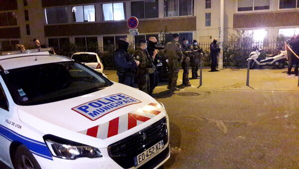 Police secures a street after a Greek Orthodox priest was shot and injured at a church in the centre of Lyon, France October 31, 2020. - Sputnik International