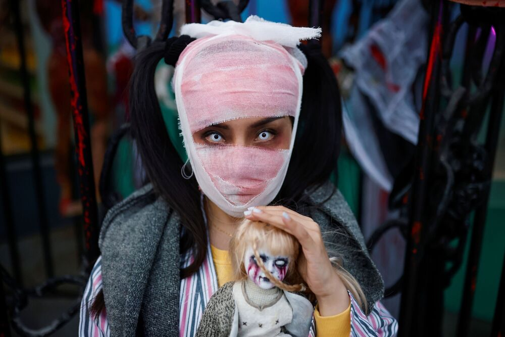 A visitor wears a costume during an event marking Halloween at an amusement park in Beijing, China, 31 October 2020.