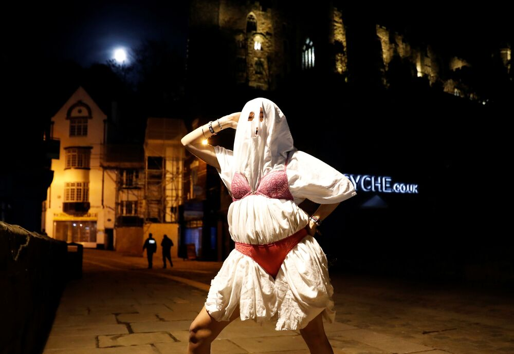 A person dressed in a costume for Halloween is seen after Britain's Prime Minister Boris Johnson announced on TV a second national lockdown, amid the outbreak of the coronavirus disease (COVID-19) in Durham, Britain, 31 October 2020.
