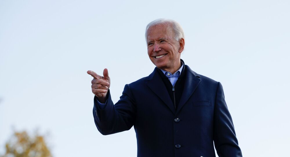 Democratic U.S. presidential nominee and former Vice President Joe Biden points a finger during a drive-in campaign stop, in Des Moines, Iowa, U.S., October 30, 2020.   REUTERS/Brian Snyder