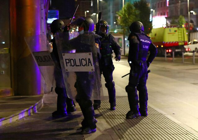 Police officers guard during a protest against the closure of bars and gyms, amidst the coronavirus disease (COVID-19) outbreak, in Madrid, Spain, November 1, 2020.