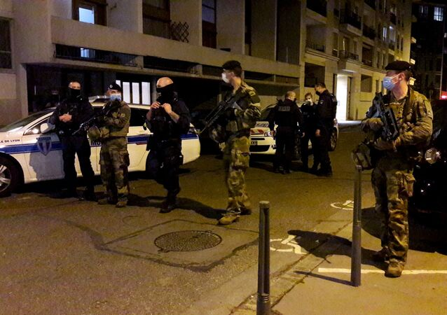 Police secures a street after a Greek Orthodox priest was shot and injured at a church in the centre of Lyon, France October 31, 2020.