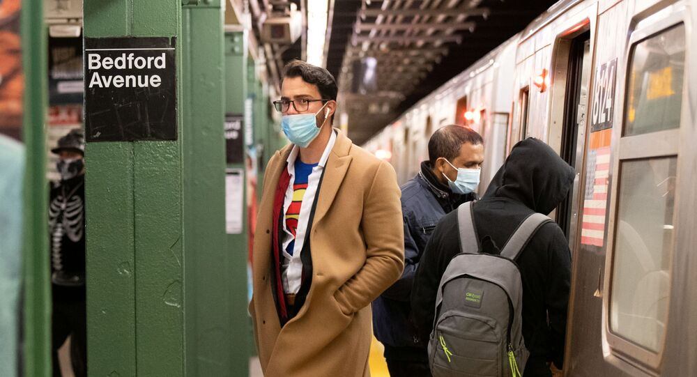 Commuters take the subway in costume on Halloween wearing masks as precautionary measure during the outbreak of the coronavirus disease (COVID-19) in Brooklyn, New York, U.S., October 31, 2020. Picture taken October 31, 2020.