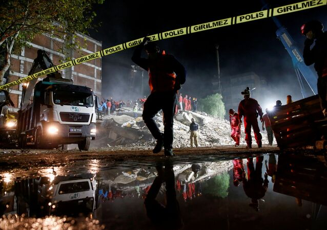 Rescue operations take place on a site secured by the police after an earthquake struck the Aegean Sea, in the coastal province of Izmir, Turkey, November 1, 2020.