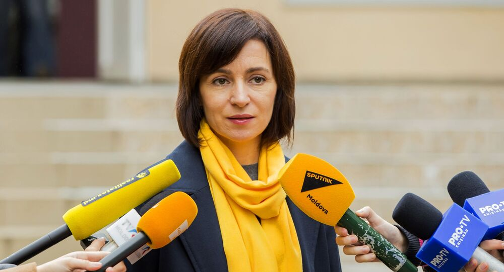 Prime Minister of the Republic of Moldova Maia Sandu answers questions from reporters during the elections at the polling station in Chisinau on October 20, 2019 during the local government elections in Moldova.