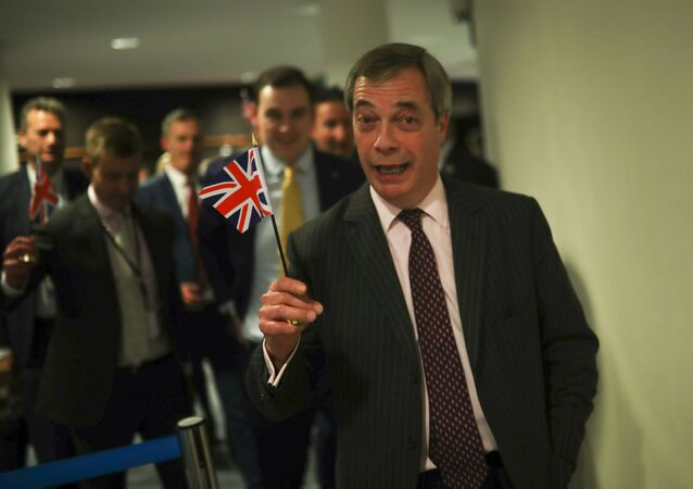 British European Parliament member Nigel Farage leaves the hemicycle after addressing European lawmakers during the plenary session at the European Parliament in Brussels, Wednesday, Jan. 29, 2020