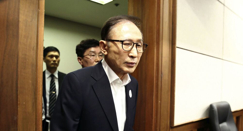 Former South Korean President Lee Myung-bak appears for his first trial at the Seoul Central District Court in Seoul Wednesday, May 23, 2018