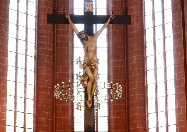 A crucifix hangs in the cathedral of Frankfurt, Germany, Thursday, Sept. 27, 2012