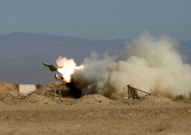 Iran's armed forces fires a missile during its air defense war game in the Isfahan province south of the capital Tehran, Iran, Wednesday, Nov. 25, 2009