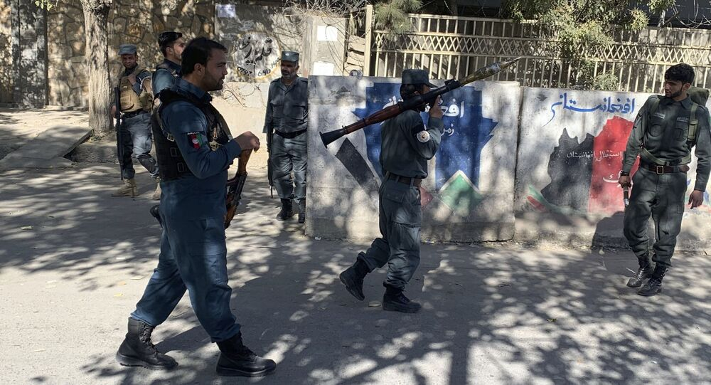 Afghan police arrive at the site of an attack at Kabul University in Kabul, Afghanistan, Monday, Nov. 2, 2020