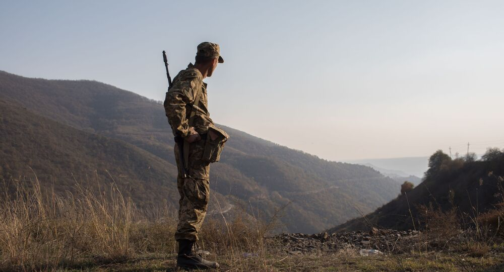 An armed man is pictured in the area of the Lachin corridor, the self-proclaimed Nagorno-Karabakh Republic