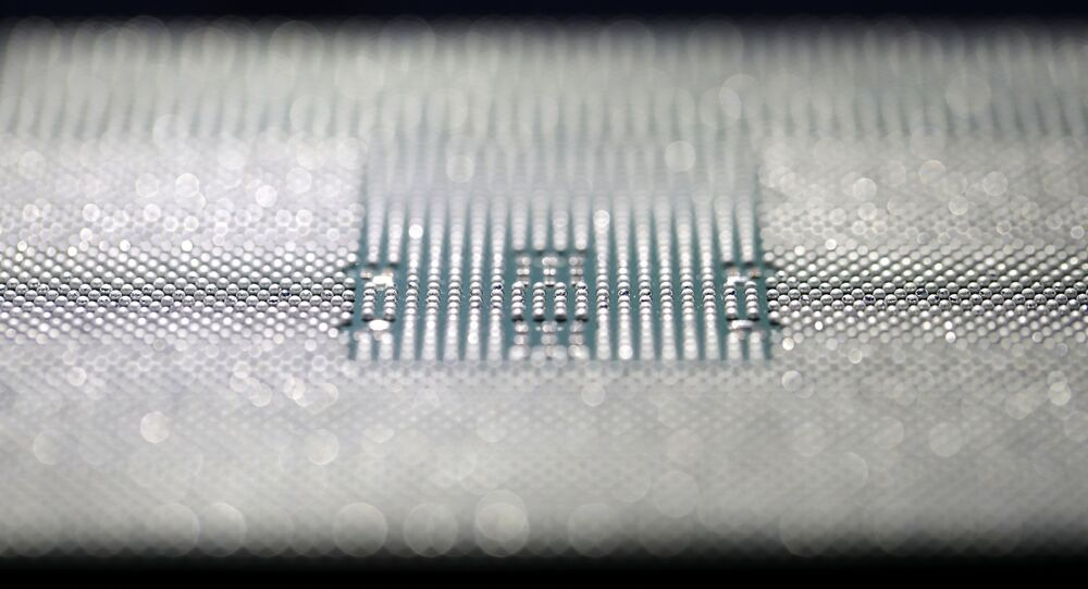 A Kunpeng 920 chip is displayed during an unveiling ceremony in Shenzhen, China, Monday, Jan. 7, 2019. Chinese telecom giant Huawei unveiled a processor chip for data centers and cloud computing as it expands into an emerging global market despite Western warnings the company might be a security risk.