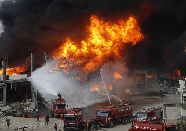 Fire burns in the port in Beirut, Lebanon, Thursday, Sept. 10. 2020