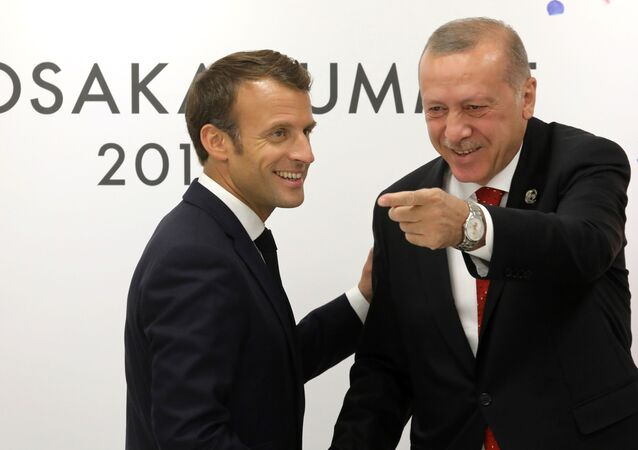 In this file photo taken on 28 June 2019 France's President Emmanuel Macron meets with Turkey's President Recep Tayyip Erdogan on the sidelines of the G20 Summit in Osaka. (Photo by Ludovic MARIN / AFP)