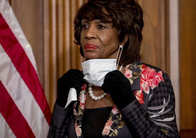 FILE - In this 23 April 2020 file photo, House Financial Services Committee Chairwoman Maxine Waters takes her mask off to speak during a signing ceremony for the Paycheck Protection Program and Health Care Enhancement Act, H.R. 266, after it passed the House on Capitol Hill, in Washington