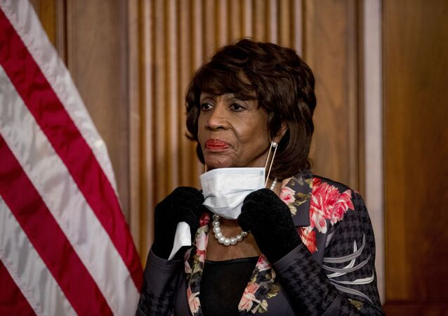 FILE - In this April 23, 2020, file photo House Financial Services Committee Chairwoman Maxine Waters, takes her mask off to speak during a signing ceremony for the Paycheck Protection Program and Health Care Enhancement Act, H.R. 266, after it passed the House on Capitol Hill, in Washington