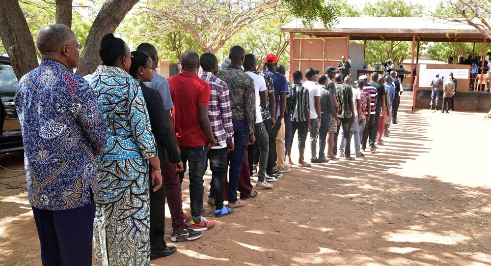 Tanzanian President John Pombe Magufuli and First Lady Janeth stand in the queue before casting their ballots at a polling centre during the Presidential and Parliamentary elections in Chamwino district in Dodoma, Tanzania October 28, 2020