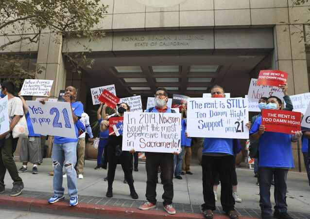 Supporters of California's Proposition 21 stage a socially distanced rally to protest at Governor Gavin Newsom's failure to tackle high rents.