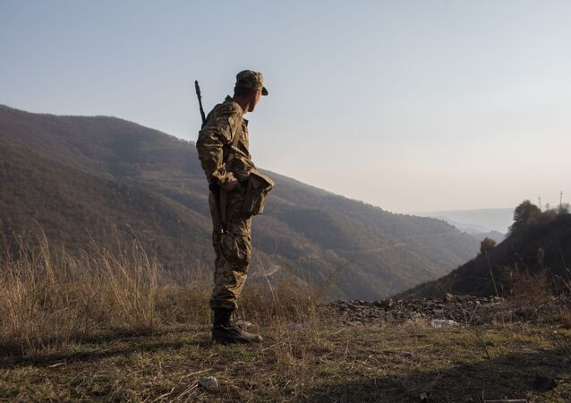An armed man is pictured in the area of the Lachin corridor, the self-proclaimed Nagorno-Karabakh Republic. The deadly confrontation between Azerbaijan and Armenia over the disputed Armenian-dominated region of Karabakh has been ongoing since late September.