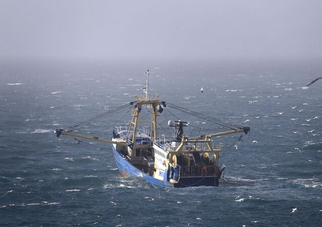 A fishing boat at work in the English Channel, off the southern coast of England, Saturday Feb. 1, 2020. The fishing industry is predicted to be one of the main subjects for negotiations between the UK and Europe, after the UK left the European Union on Friday.