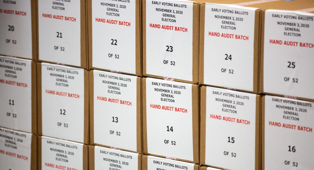 Ballots are pulled aside for a hand audit by Maricopa County Elections Department staff ahead of Tuesdays election on 31 October 2020 in Phoenix, Arizona. Early voting lasted from 7 to 30 October in Arizona, which had a record number of early voters.