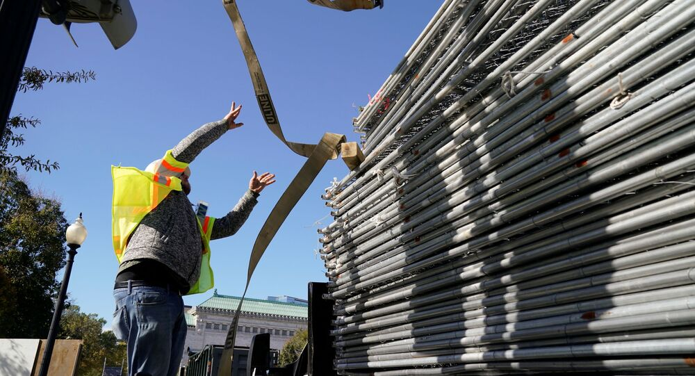 A workers works on a stack of fencing near a security checkpoint on the South side of the White House, the day before the U.S. presidential election, in Washington, U.S., November 2, 2020.