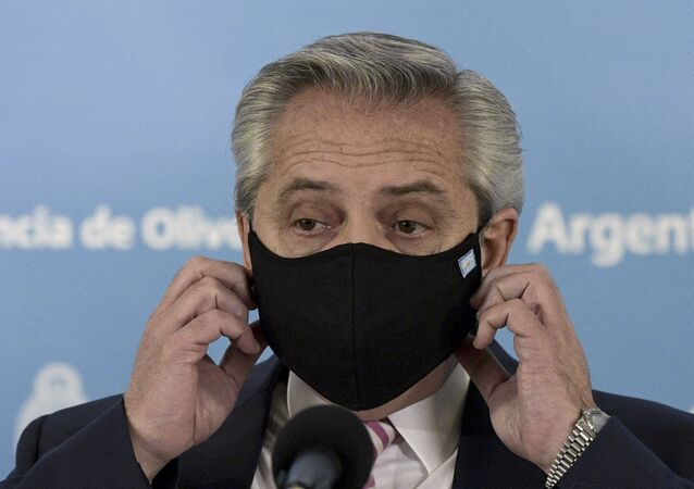 Wearing a mas to curb the spread of COVID-19, Argentine President Alberto Fernandez arrives for a press conference to announce that Argentina and Mexico will produce and distribute an experimental coronavirus vaccine, at the Olivos Presidential Residence in Olivos, Buenos Aires, Wednesday, August 12, 2020.