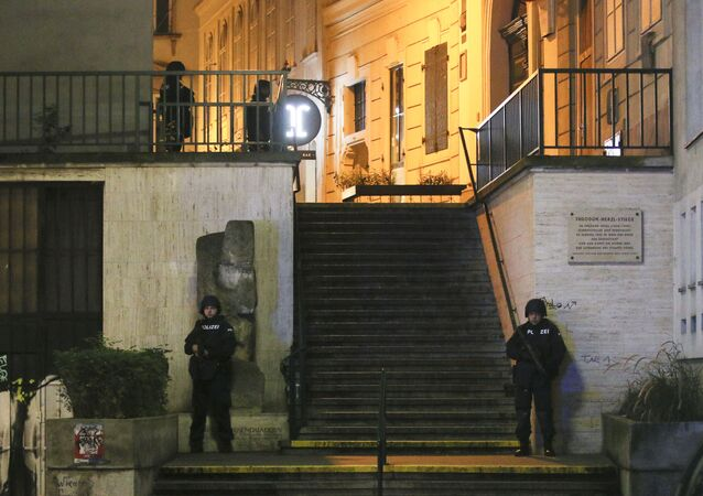 Police officers stay in position at stairs named 'Theodor Herzl Stiege' near a synagogue after gunshots were heard, in Vienna, Monday, Nov. 2, 2020. Austrian police say several people have been injured and officers are out in force following gunfire in the capital Vienna. Initial reports that a synagogue was the target of an attack couldn't immediately be confirmed. Austrian news agency APA quoted the country's Interior Ministry saying one attacker has been killed and another could be on the run.