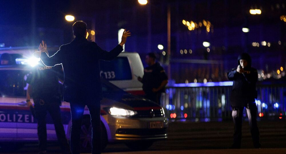 Police officers check a man on a street after exchanges of gunfire in Vienna, Austria November 2, 2020