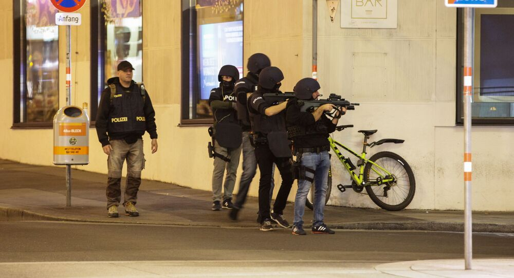 Police officers aim their weapons on the corner of a street after exchanges of gunfire in Vienna, Austria November 2, 2020