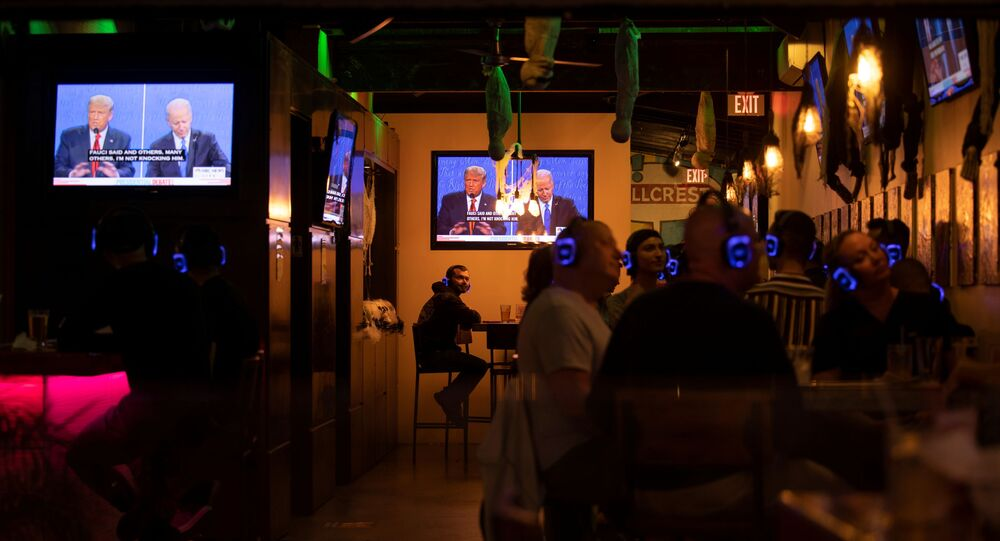 U.S. President Donald Trump and Democratic presidential candidate Joe Biden's presidential debate is broadcast on television and watched at a tavern in San Diego, California, U.S., October 22, 2020