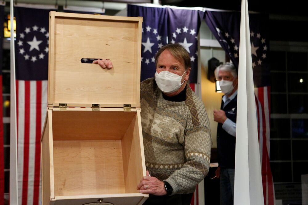 Town moderator Tom Tillotson shows an empty box for ballots for the US presidential election at Hale House in the Balsams Resort in the hamlet of Dixville Notch, New Hampshire, US, 3 November 2020.