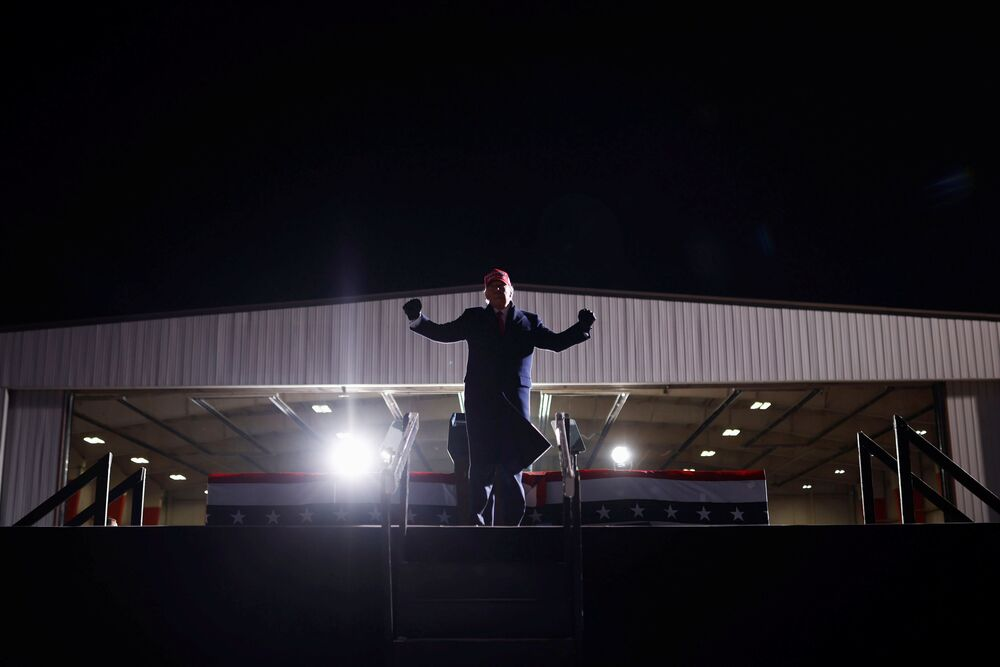 US President Donald Trump gestures at a campaign rally at Cherry Capital Airport in Traverse City, Michigan, US, 2 November 2020.