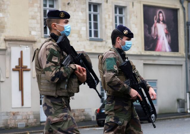 French soldiers patrol near the Saint Gery church in Cambrai as the country has raised the security alert for its territory to the highest level after the knife attack in the city of Nice, France, November 1, 2020