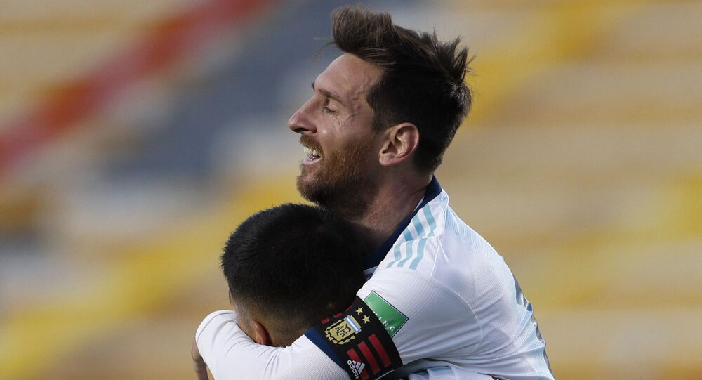 Argentina's Joaquin Correa (9) celebrates scoring his side's second goal against Bolivia with teammate Lionel Messi during a qualifying soccer match for the FIFA World Cup Qatar 2022 in La Paz, Bolivia, Tuesday, 13 October 2020.