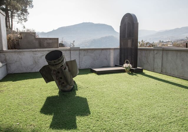 A missile from a multiple rocket launcher is seen at a cemetery in Stepanakert, the self-proclaimed Nagorno-Karabakh Republic.