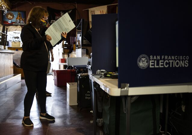 A voter casts a ballot at a polling station in Friends Bar on 3 November 2020 in San Francisco, California. After a record-breaking early voting turnout, Americans head to the polls on the last day to cast their vote for incumbent US President Donald Trump or Democrat nominee Joe Biden in the 2020 presidential election.