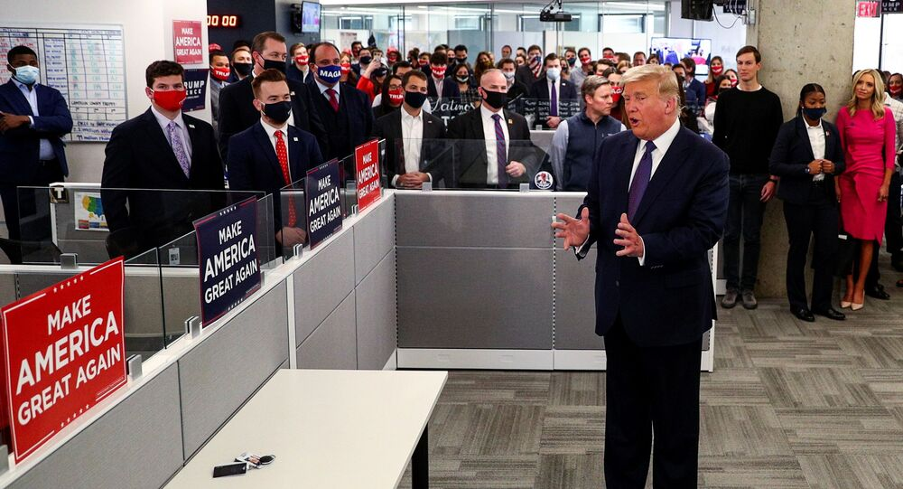 U.S. President Donald Trump greets staff members as he visits his presidential campaign headquarters on Election Day in nearby Arlington, Virginia, US, 3 November 2020. REUTERS/Tom Brenner